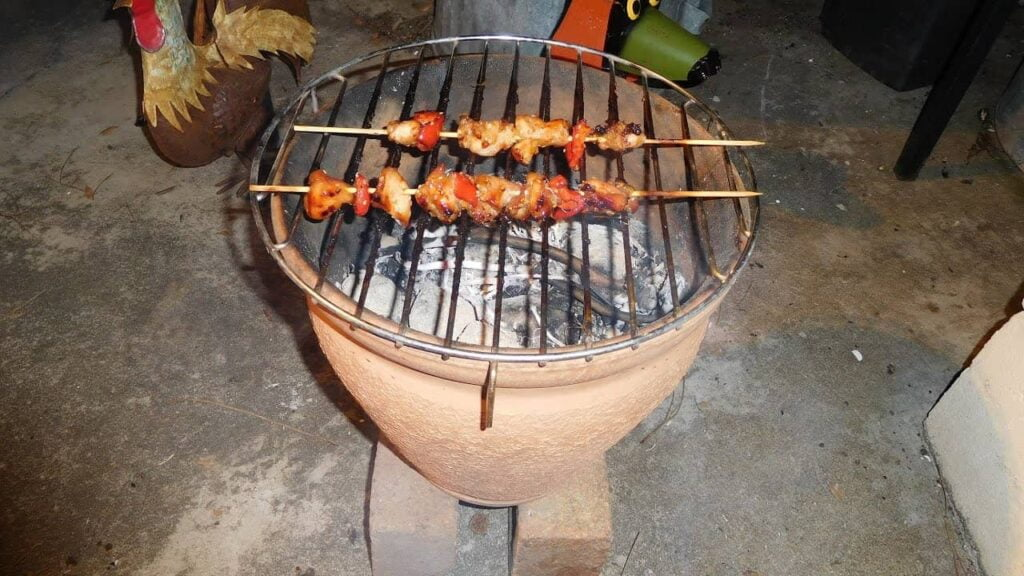 Charcoal grill with terracotta pot
